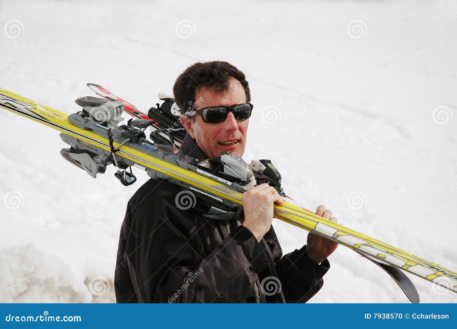 Man carrying skis