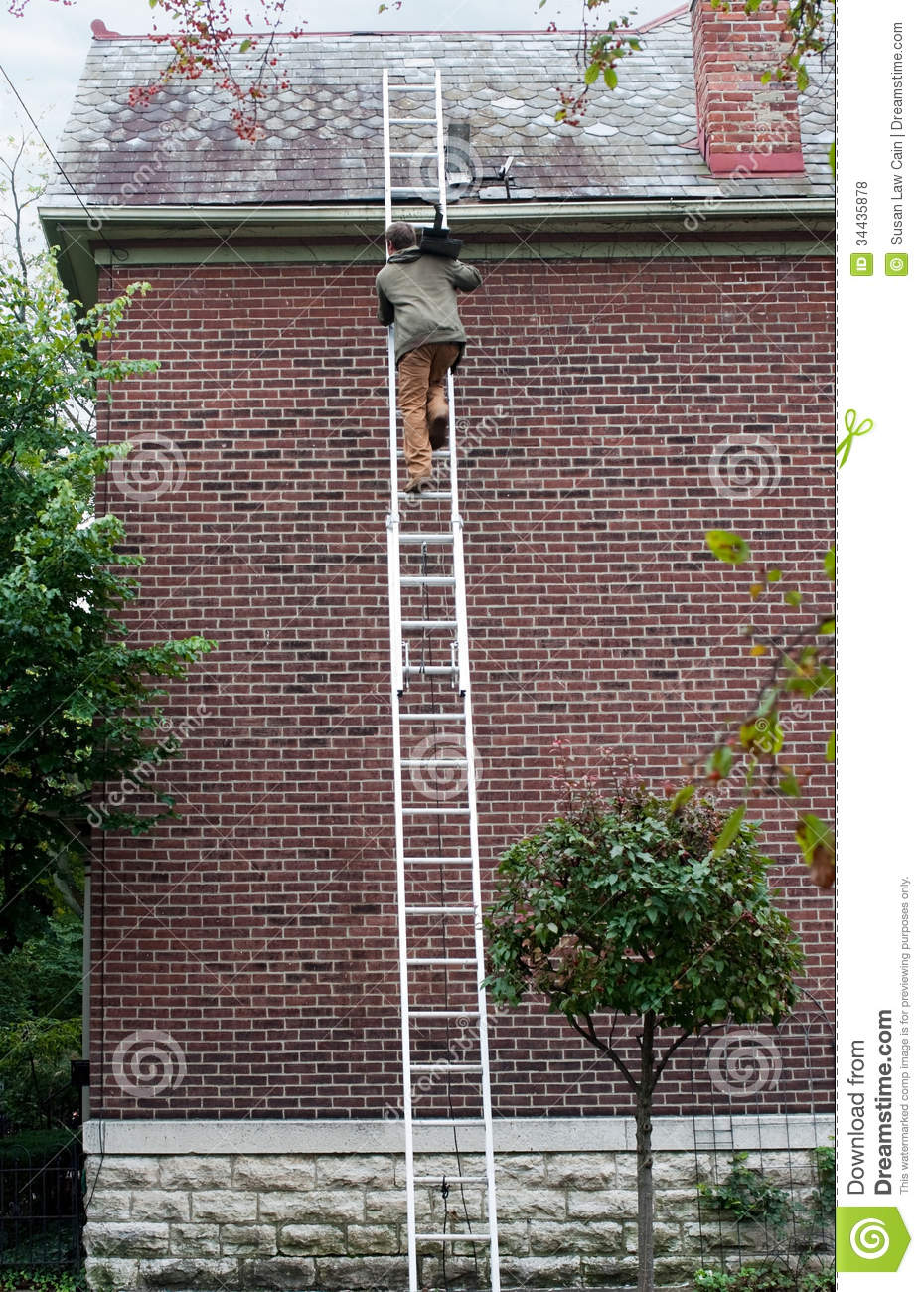 Man Carrying Slate Up Ladder Royalty Free Stock Photos