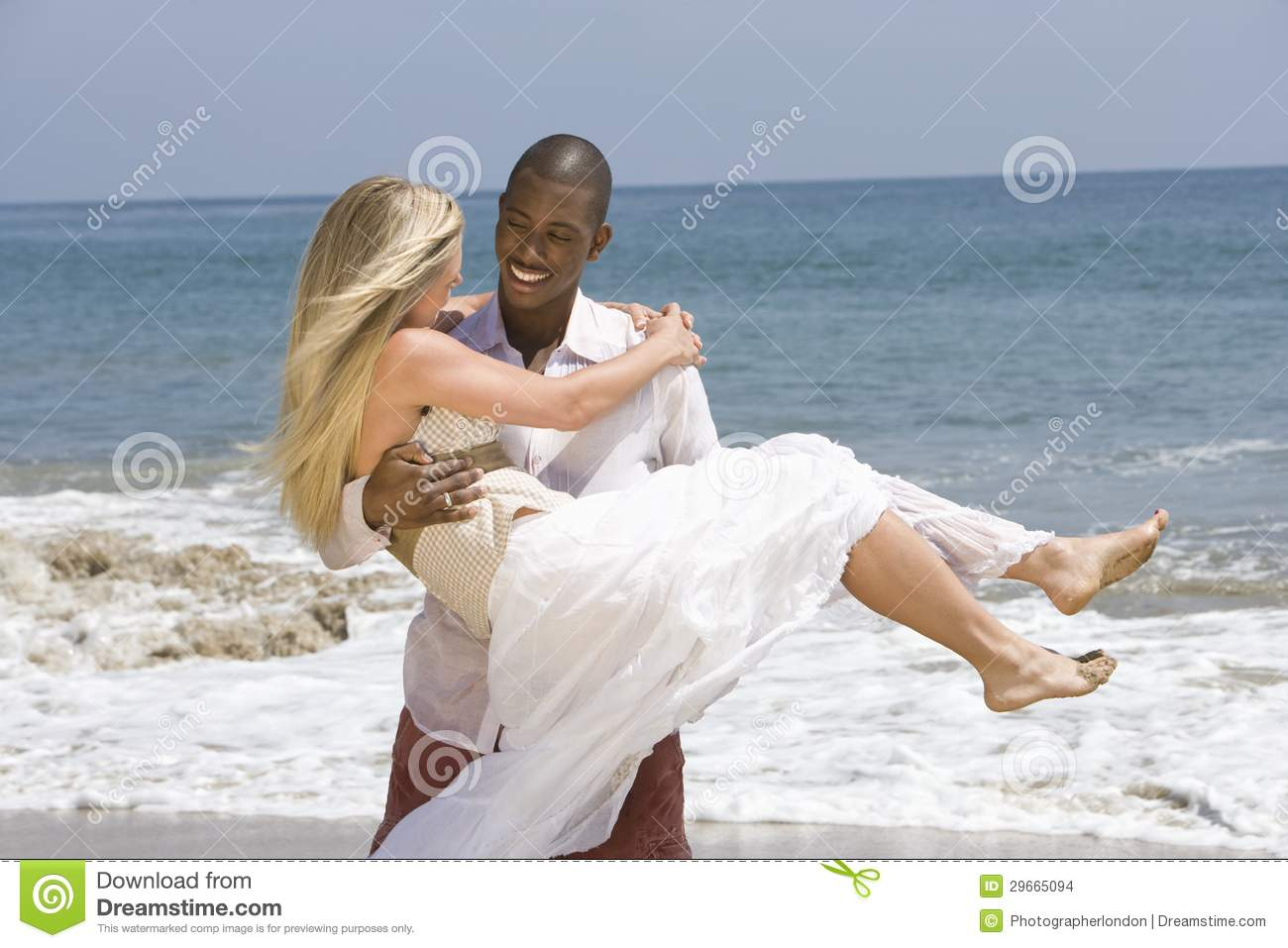 Man Carrying Woman at Beach