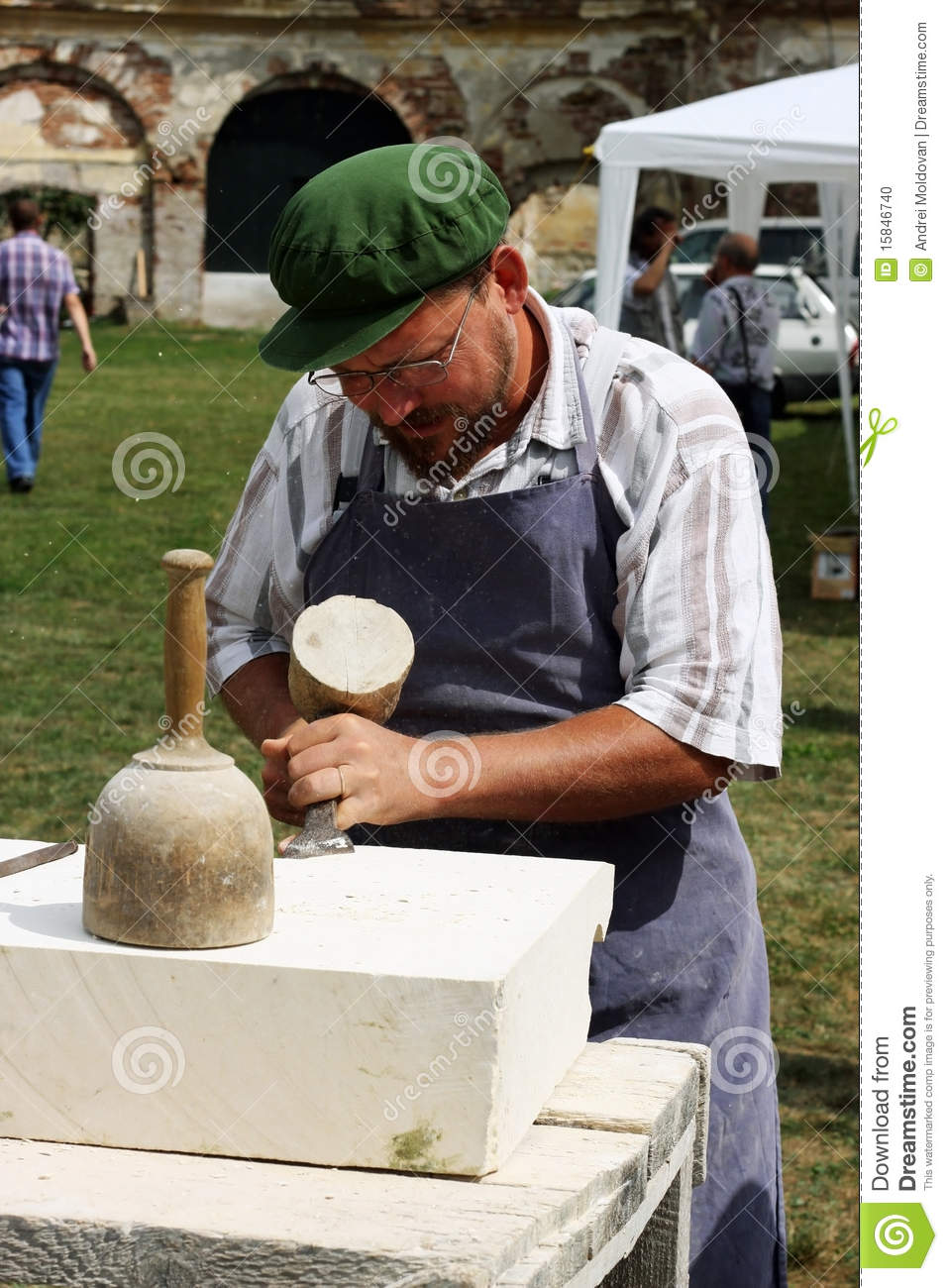 Man carving in stone