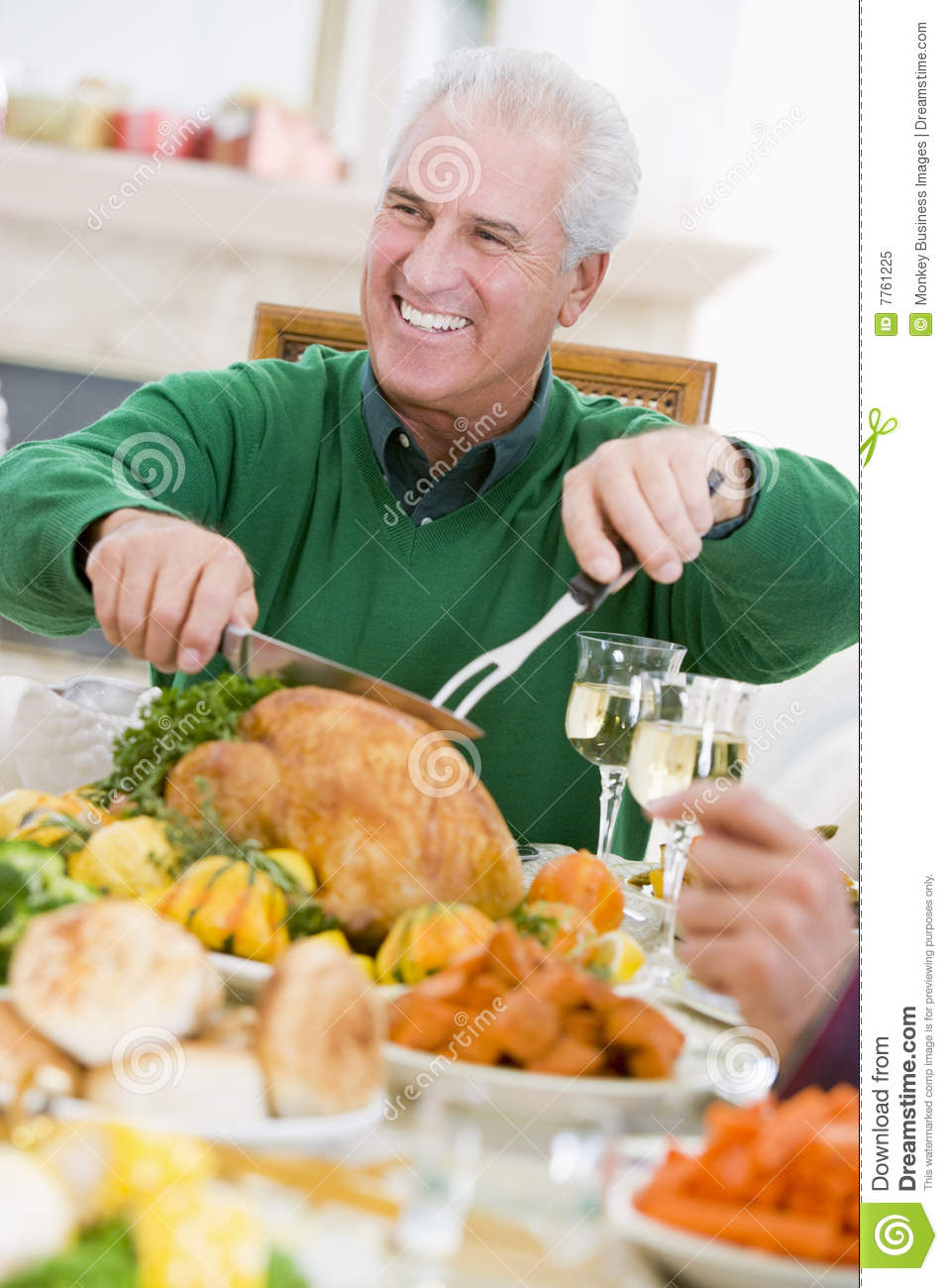 Man Carving Up Turkey At Christmas Dinner Stock Image