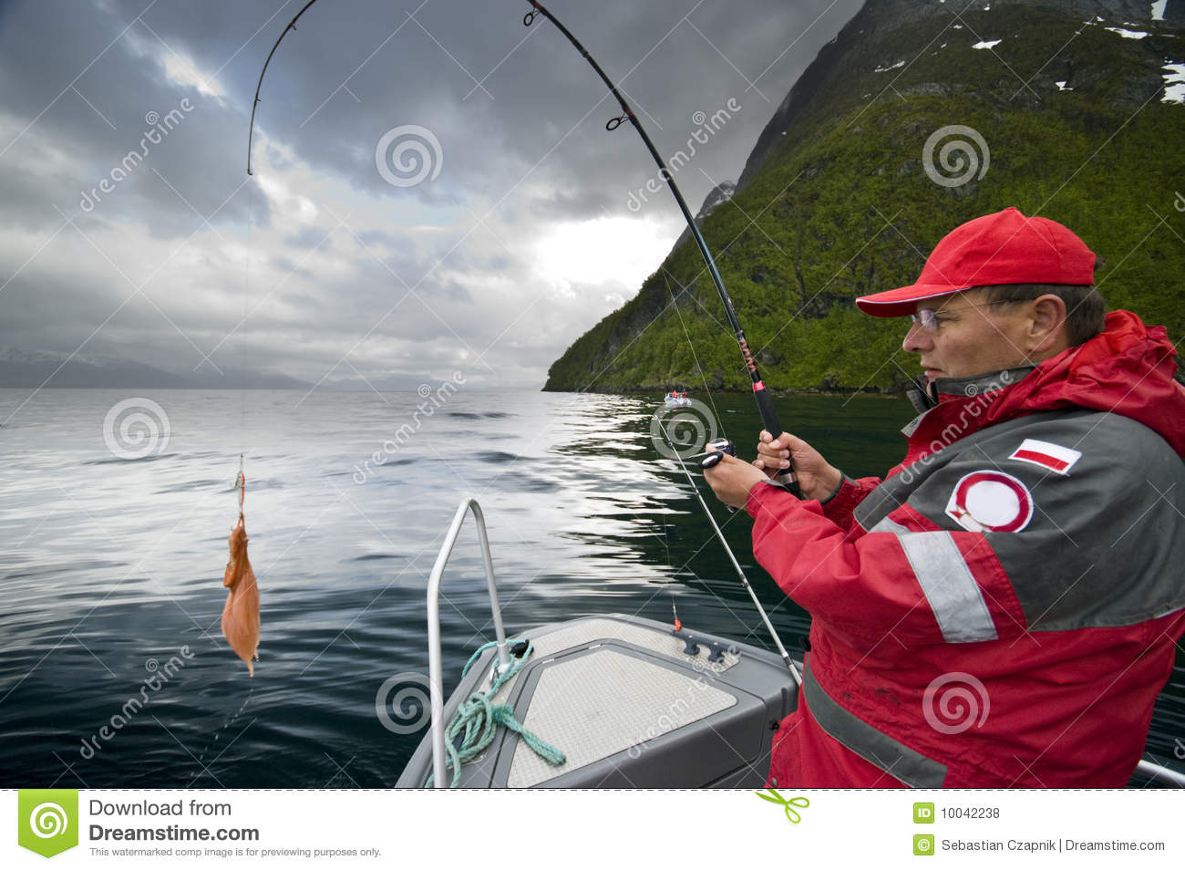 Man Catching Fish Stock Photo Image Of Outdoor Boat
