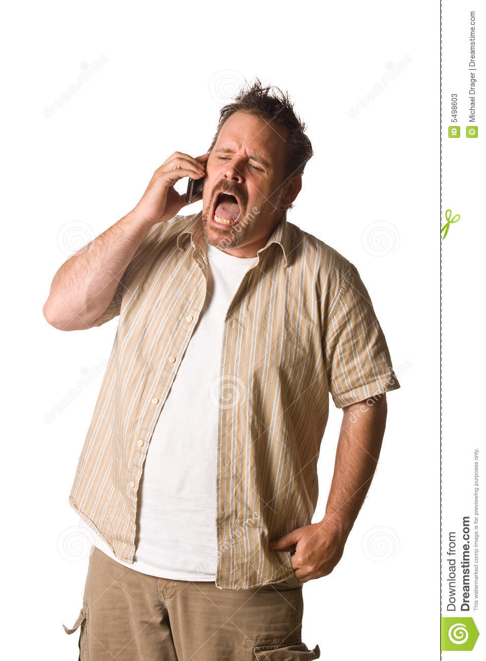 Man On Cell Phone : Young casual man talking on the phone stock image
