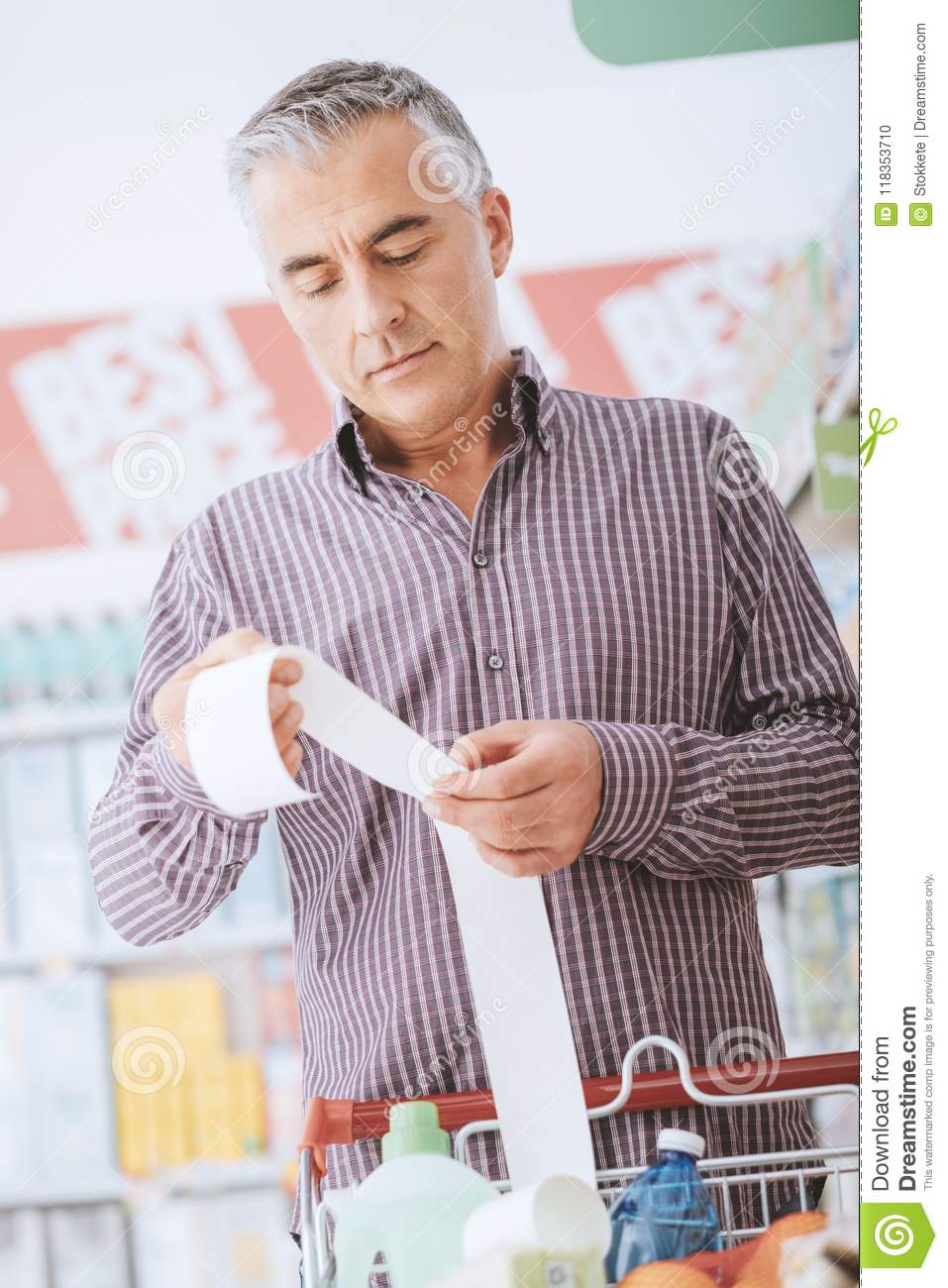 Man checking a grocery receipt