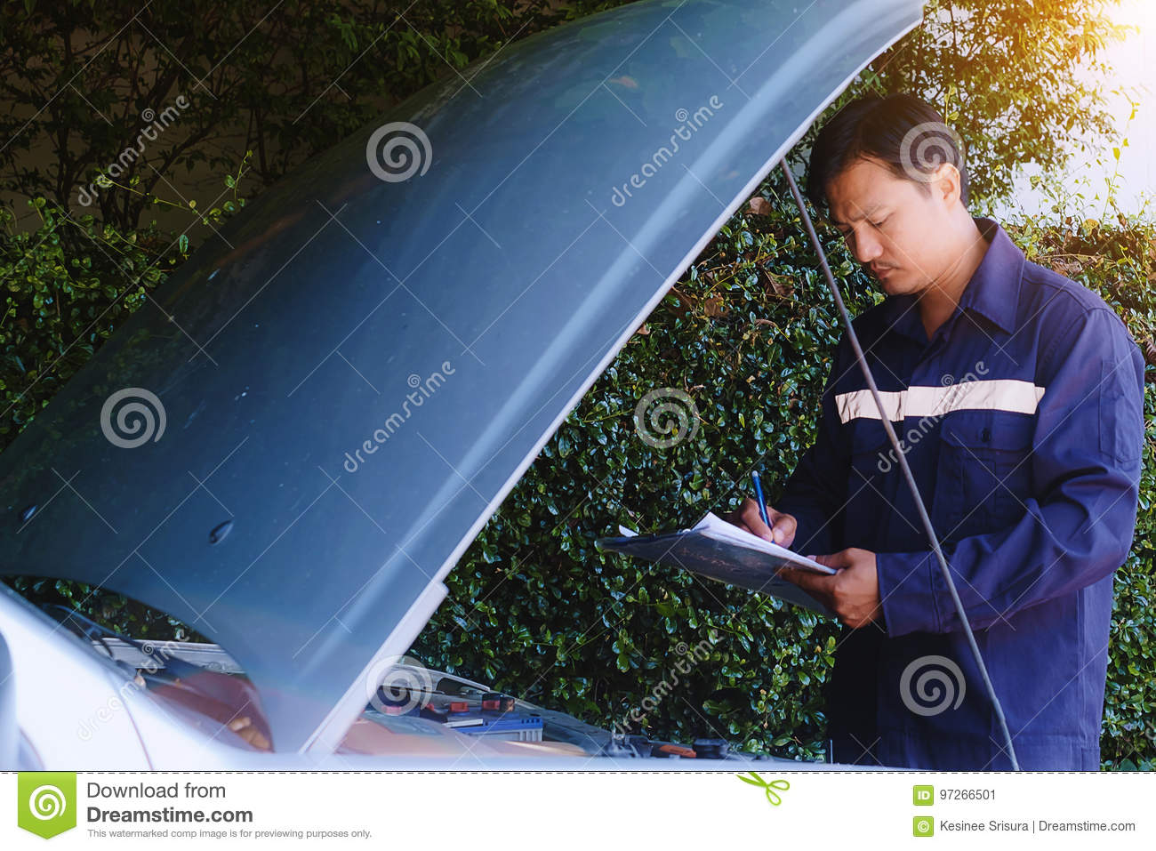 Man checking the list of items to repair the car