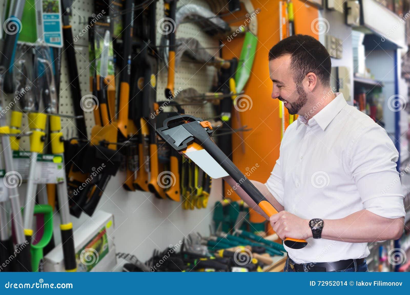Man choosing big hacker stock photo  Image of instrument