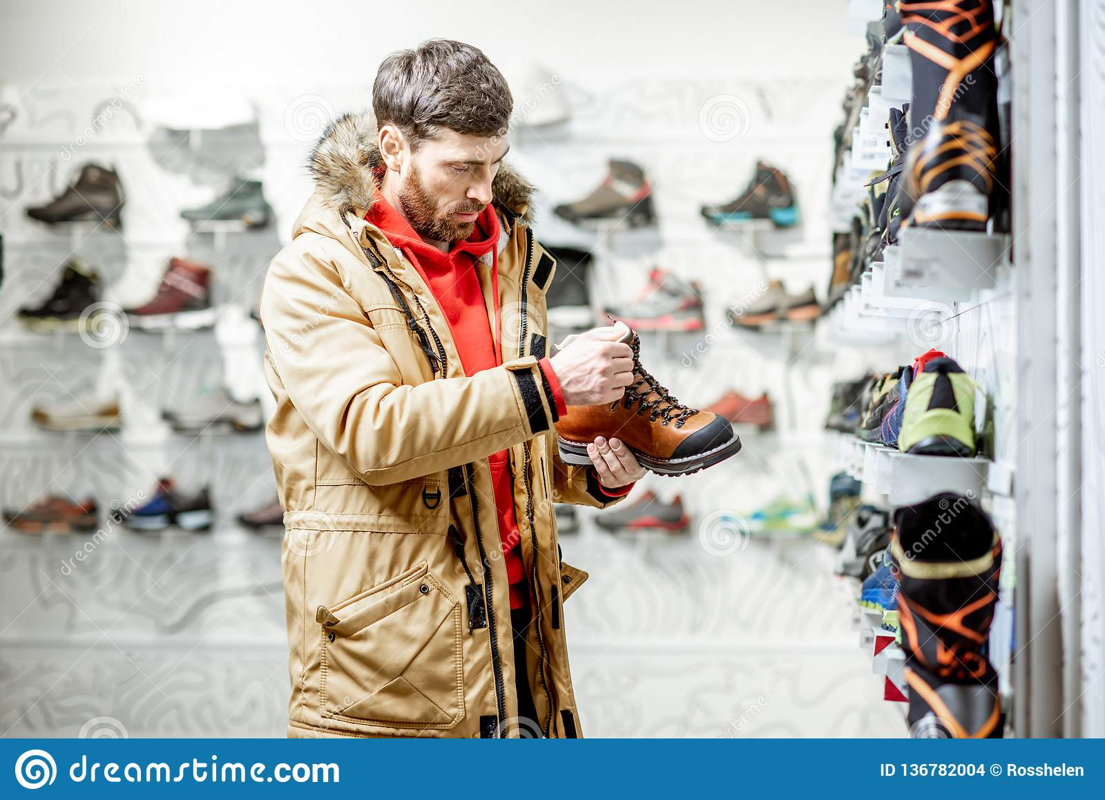 Man Choosing Shoes For Hiking Stock
