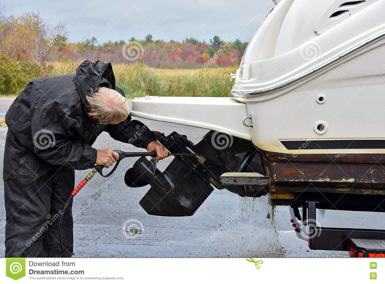 man cleaning boat propeller stock photo image of fall trailer