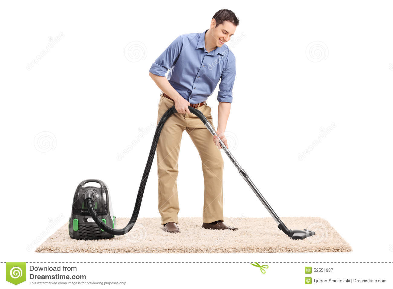 Man Cleaning A Carpet With Vacuum Cleaner Stock Photo