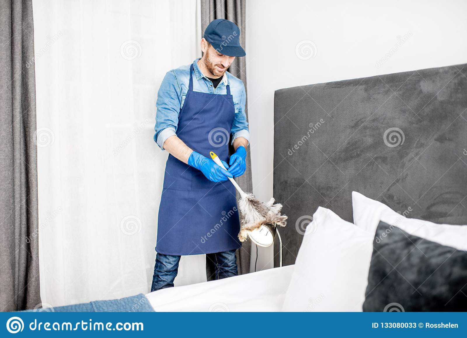 Man Cleaning In The Hotel Room Stock Image - Image of