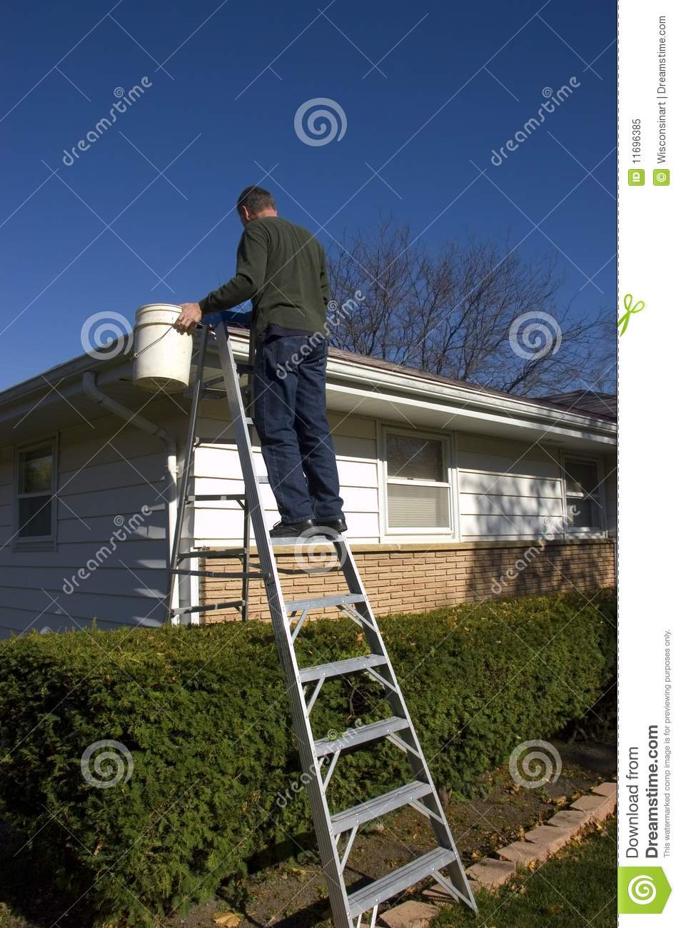 Man Cleaning Rain Gutters, Inspecting House Roof Royalty ...