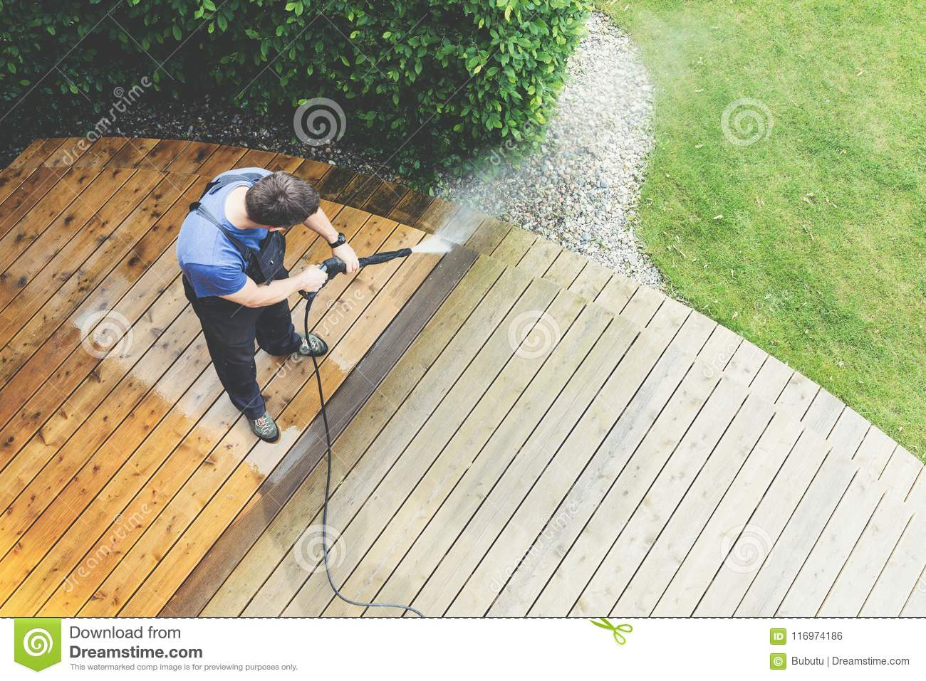 Cleaning terrace with a power washer - high water pressure clean