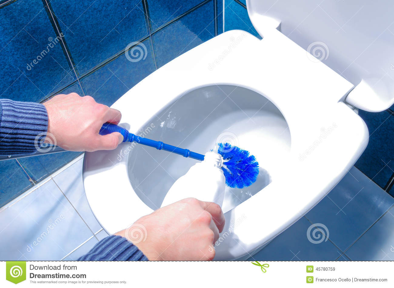 Man Cleaning Toilet Using Brush And Liquid Cleaner Stock