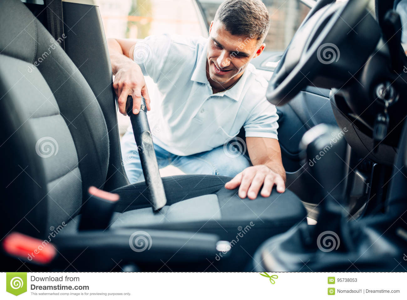 Man Cleans Car Interior With Vacuum Cleaner Stock Image