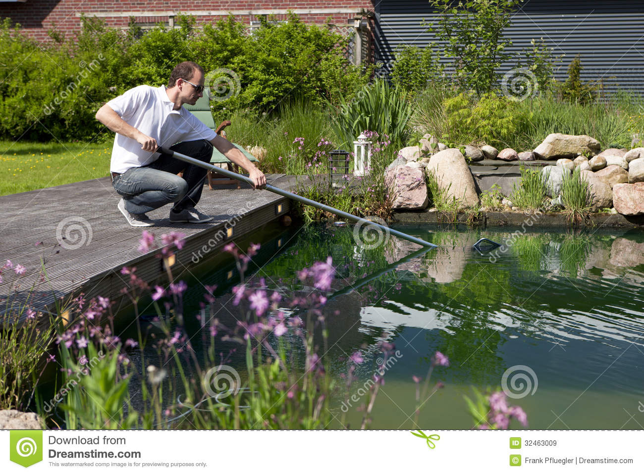 Man cleanse his garden pond royalty free stock images for Garden pond unlimited