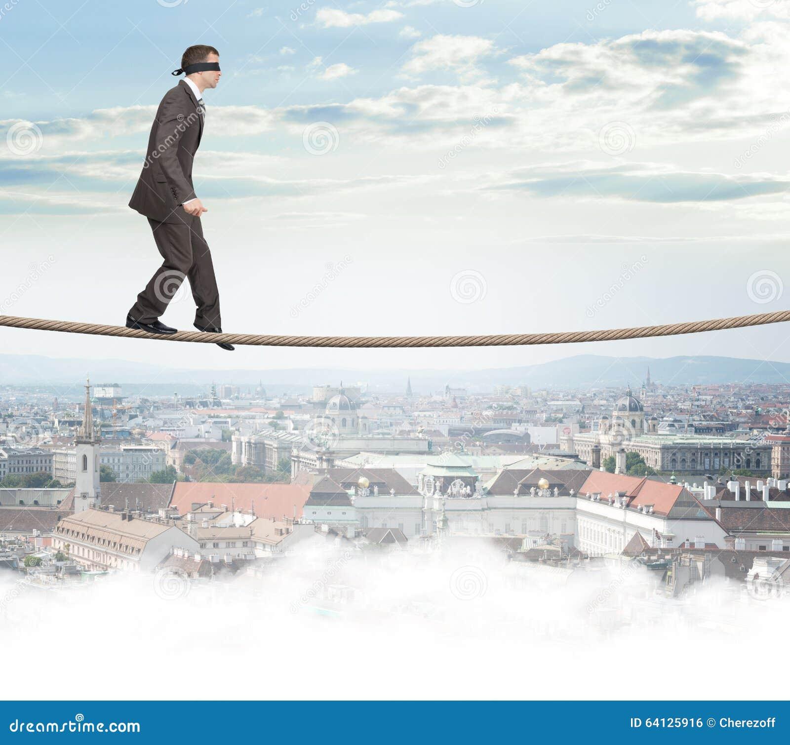 Man With Closed Eyes Softly Walking On Rope Stock Photo