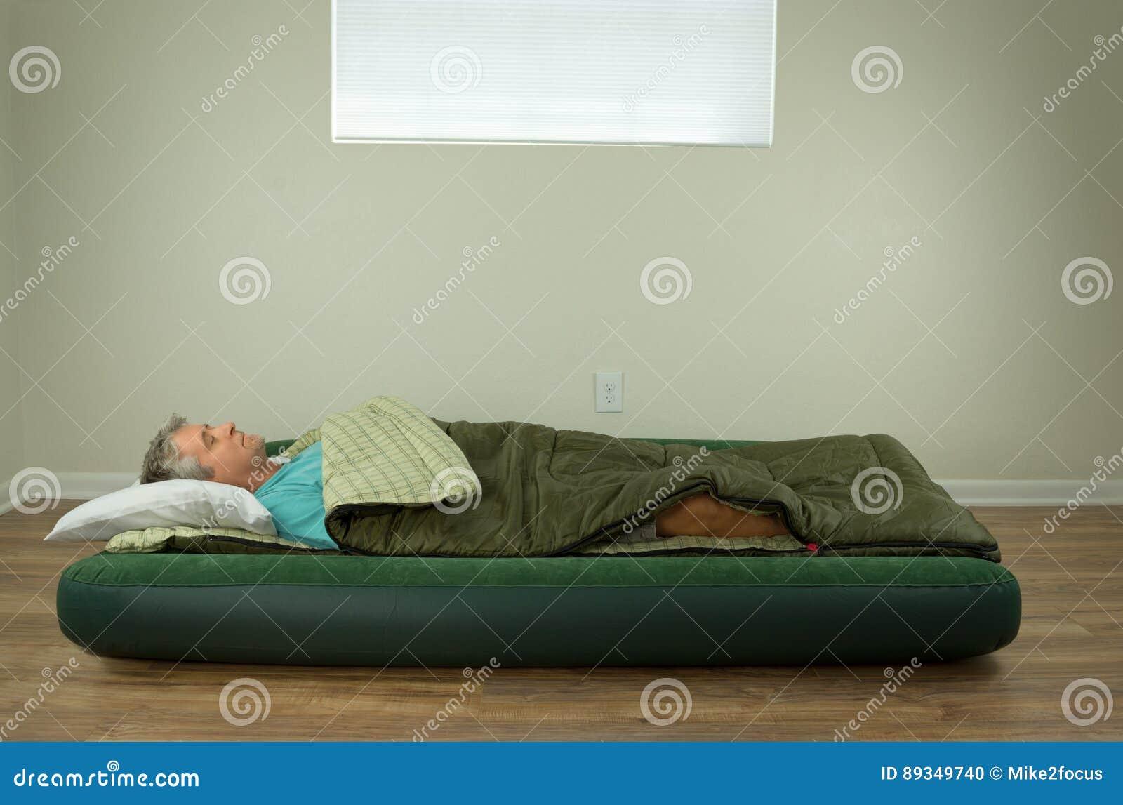 Man Comfortably Sleeping On Blow Up Air Mattress Bed In Sleeping