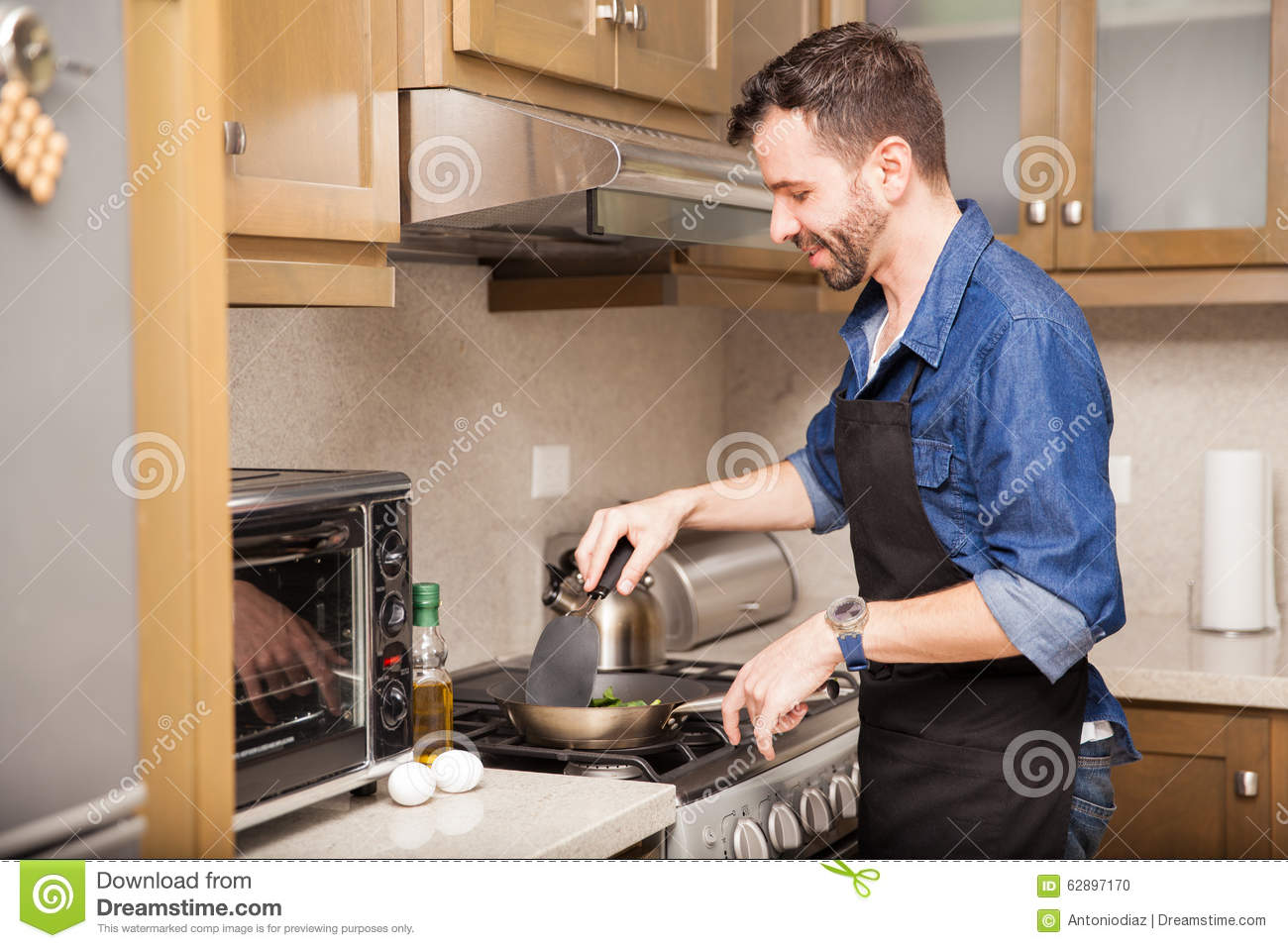 Man Cooking Breakfast At Home Stock Photo - Image: 62897170