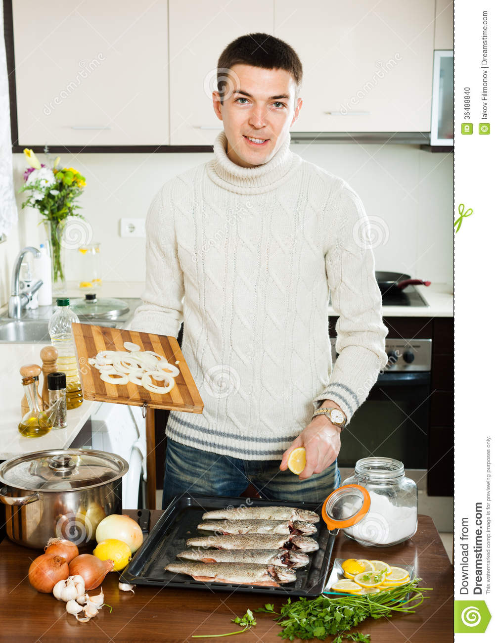 Man Cooking Fish In Baking Sheet At Home Stock Photo ...