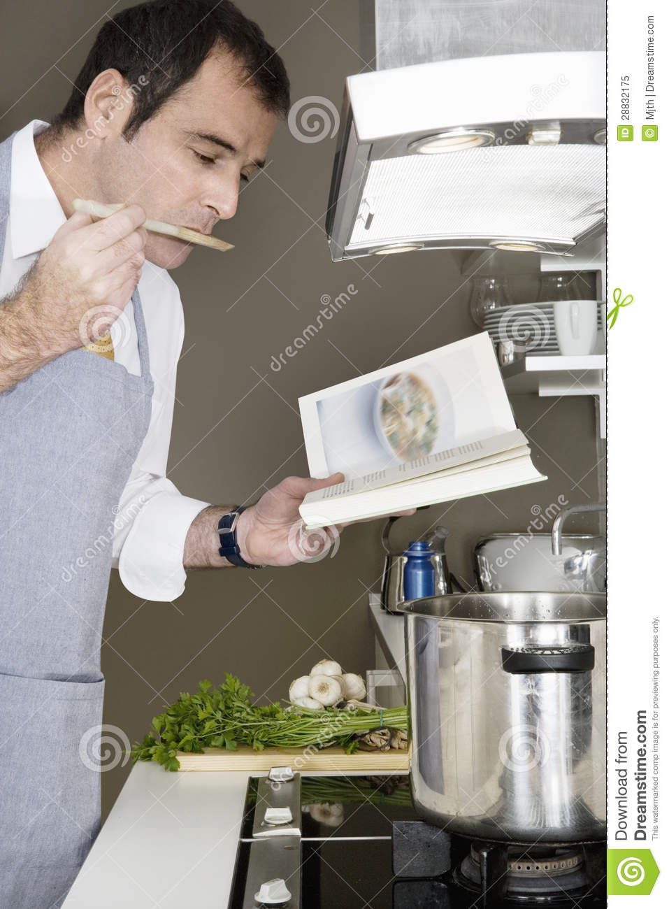 Man Cooking At Home Royalty Free Stock Photo - Image: 28832175