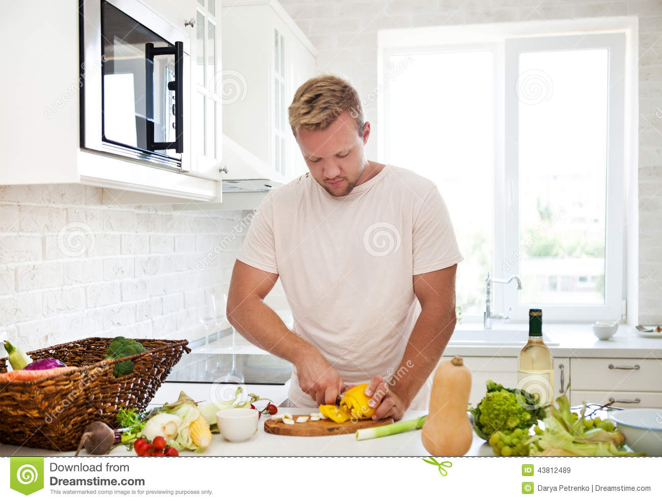 Man Cooking At Home Preparing Salad In Kitchen Stock Photo ...