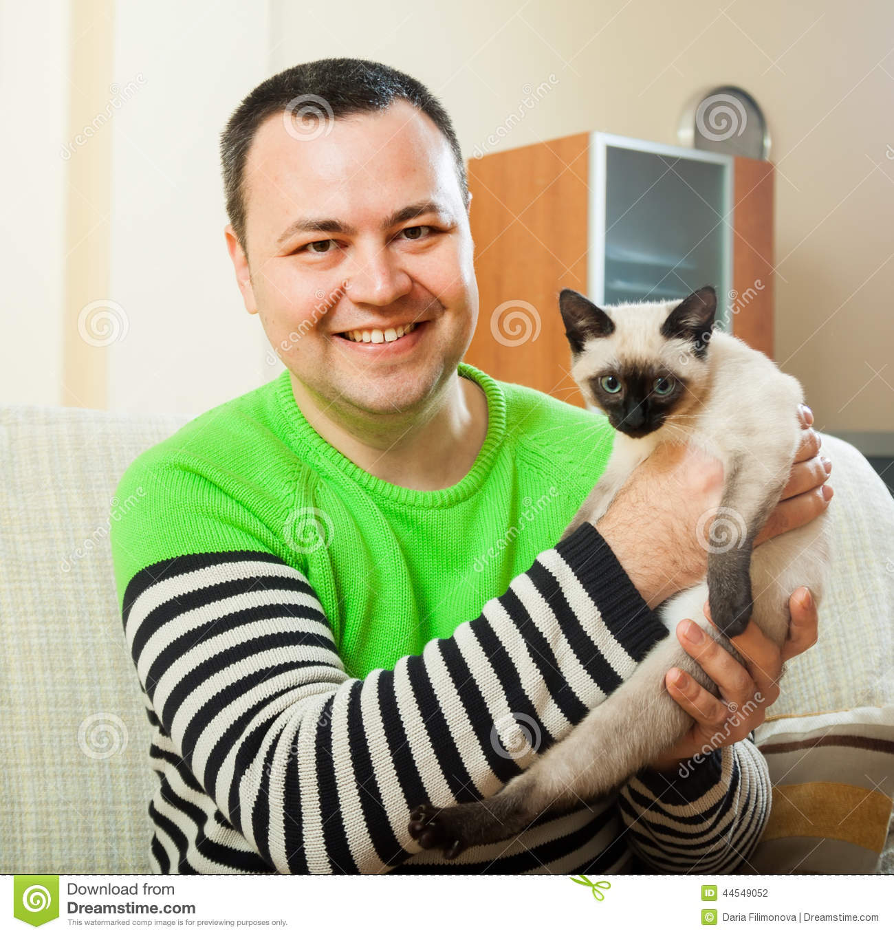 Man on couch with little pet