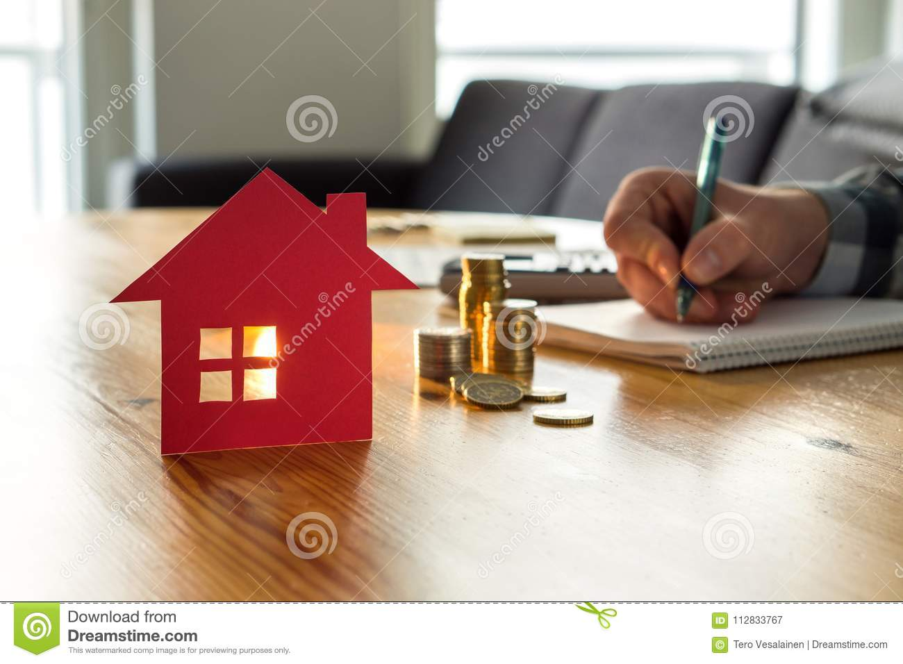 Man counting house price, home insurance cost, property value.