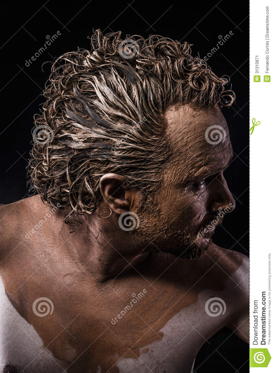 Muscular Naked Man Covered With Paint And Mud Skin Stock