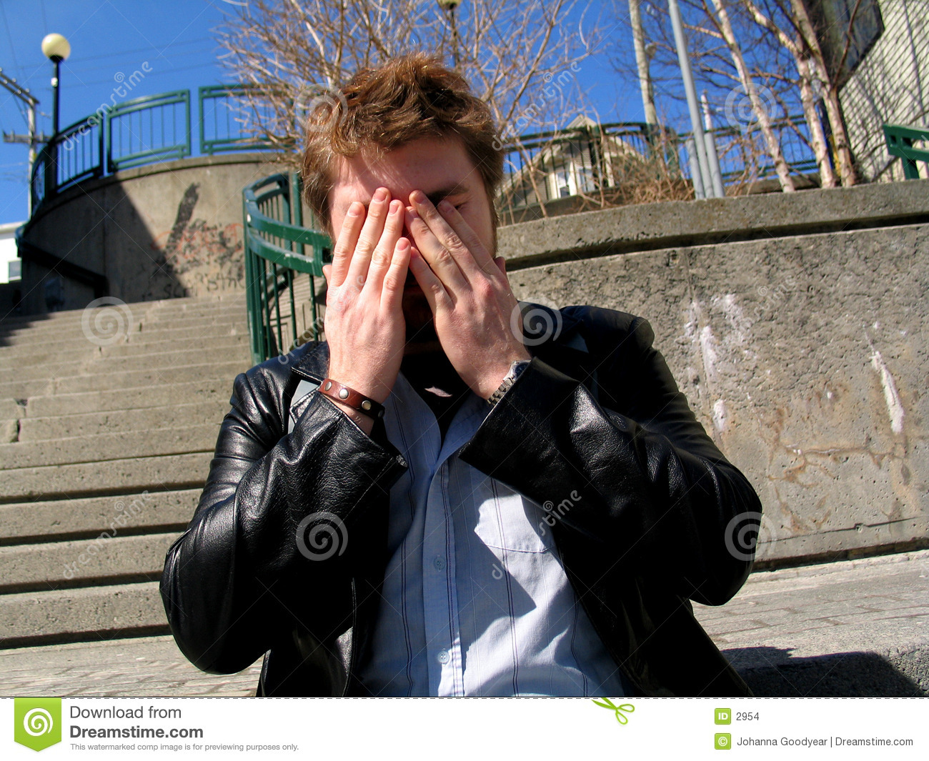 Man Covering Face