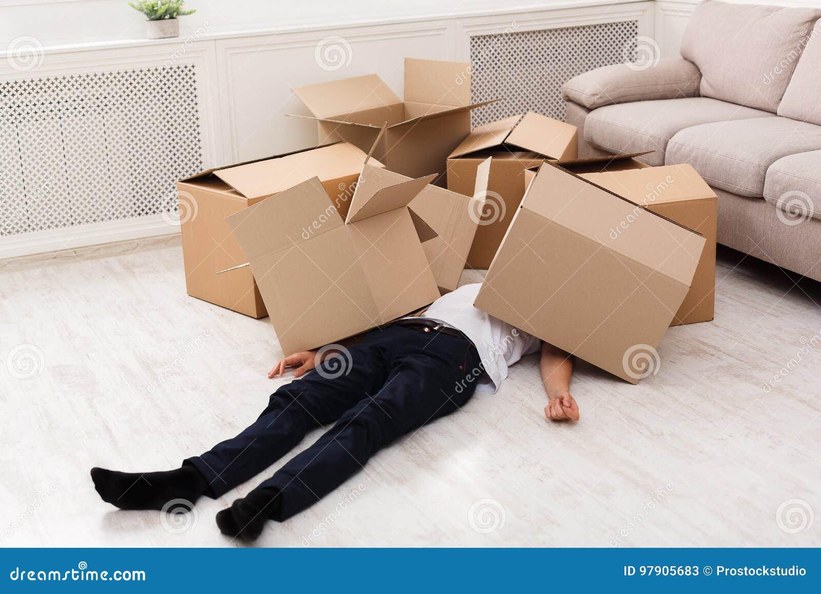 Man crushed underneath cardboard boxes