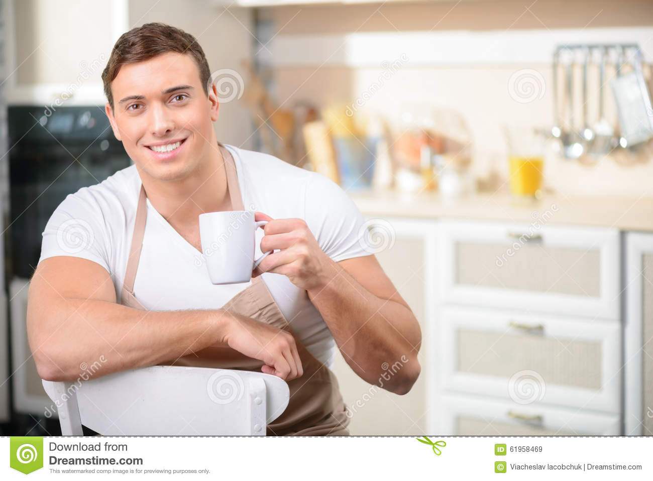 Man With A Cup Of Drink In The Kitchen Stock Image - Image of ...