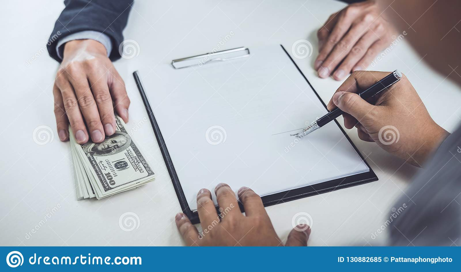 Man customer signing buying home policy document agreement, successful loan contract and salesman receive money after good deal