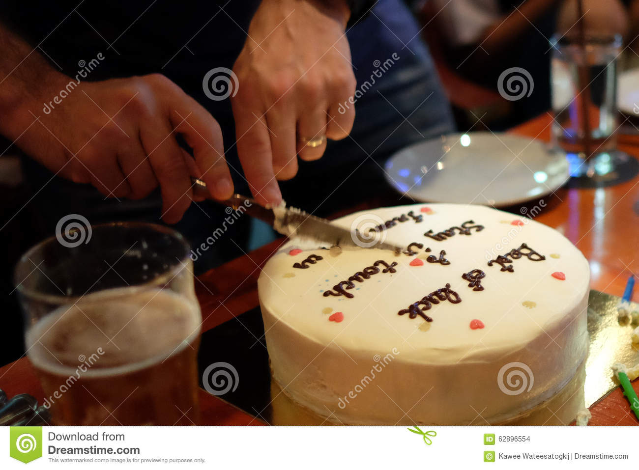 Man Cutting Birthday Cake In Dimmed Light Pub Party Concept