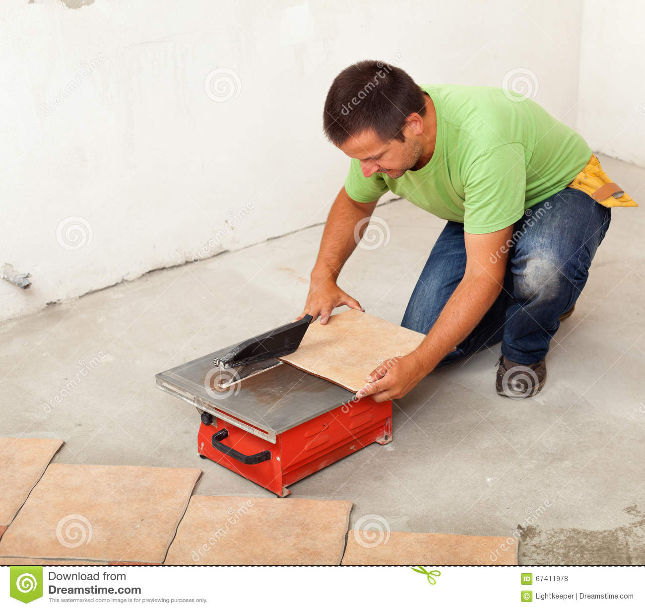 Man Cutting Ceramic Floor Tile Stock Photo Image Of Repair Young