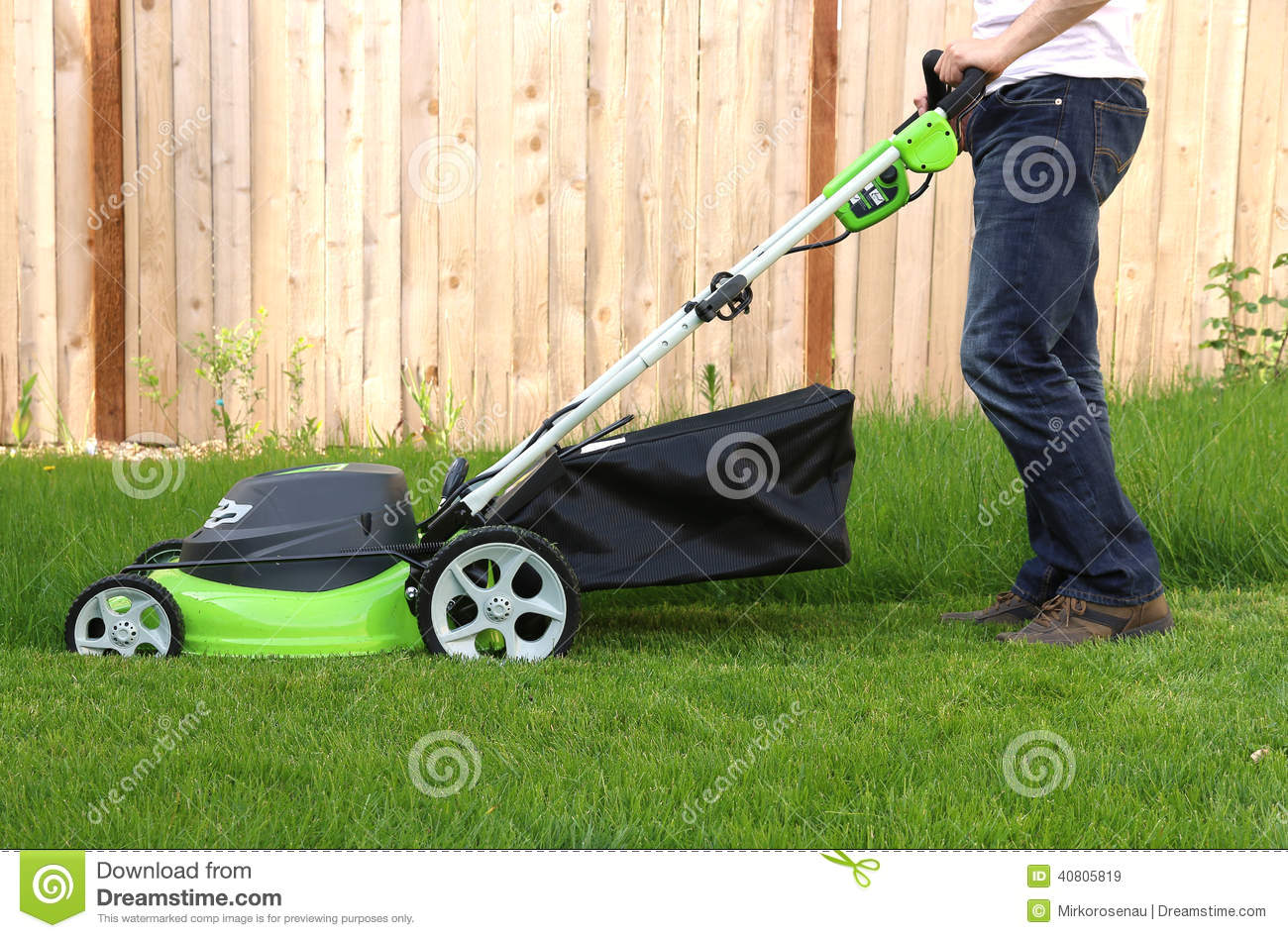 Man cutting the grass with lawn mower stock image image for Lawn mower cutting grass