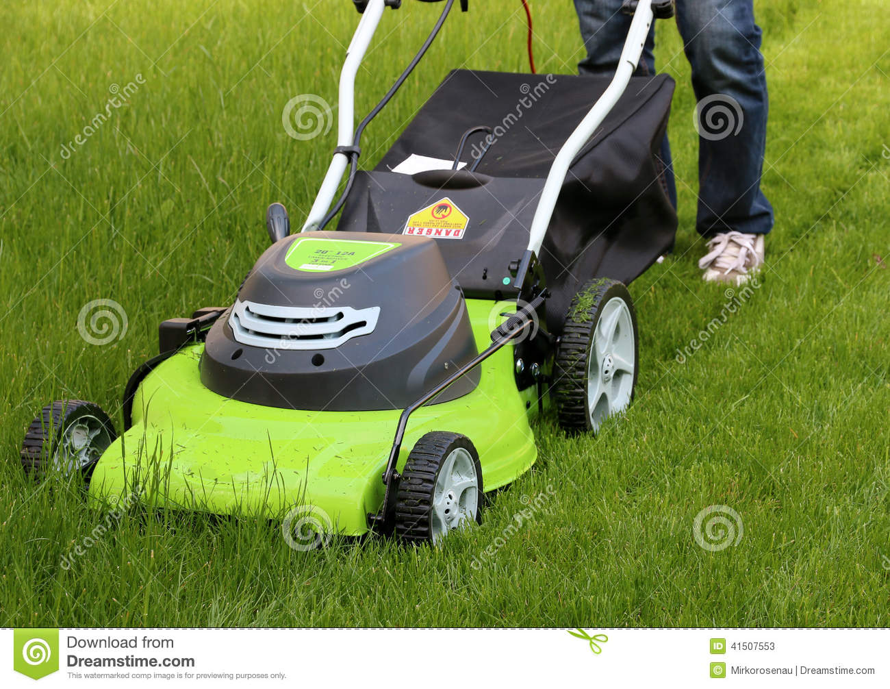Man cutting the grass with lawn mower stock photo image for Lawn mower cutting grass