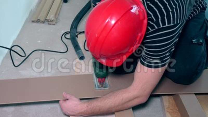 Man Cutting Laminate Flooring With Electric Hand Saw Stock Video