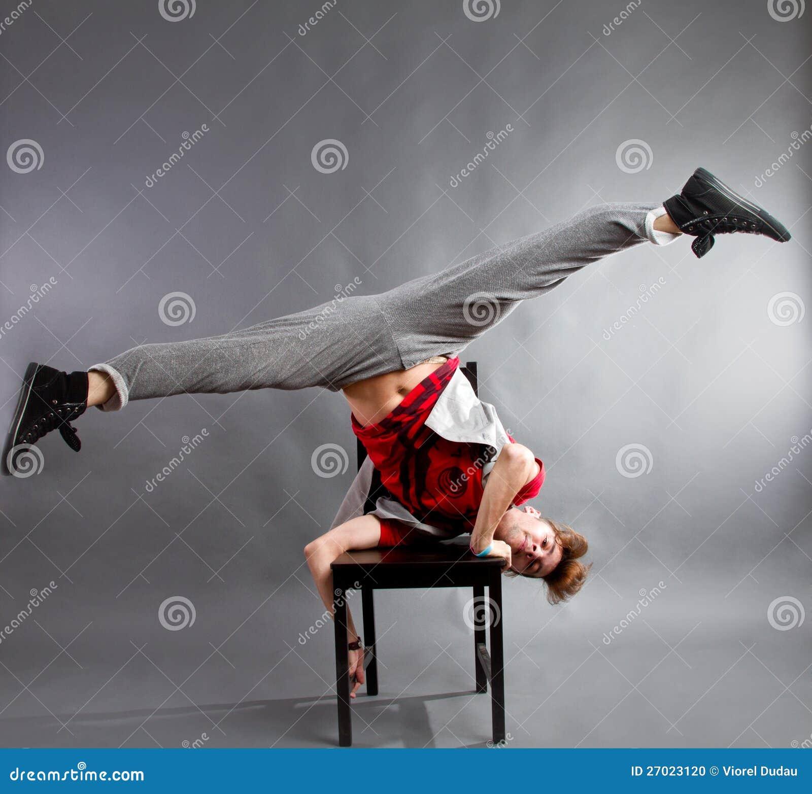 Man dancing on chair