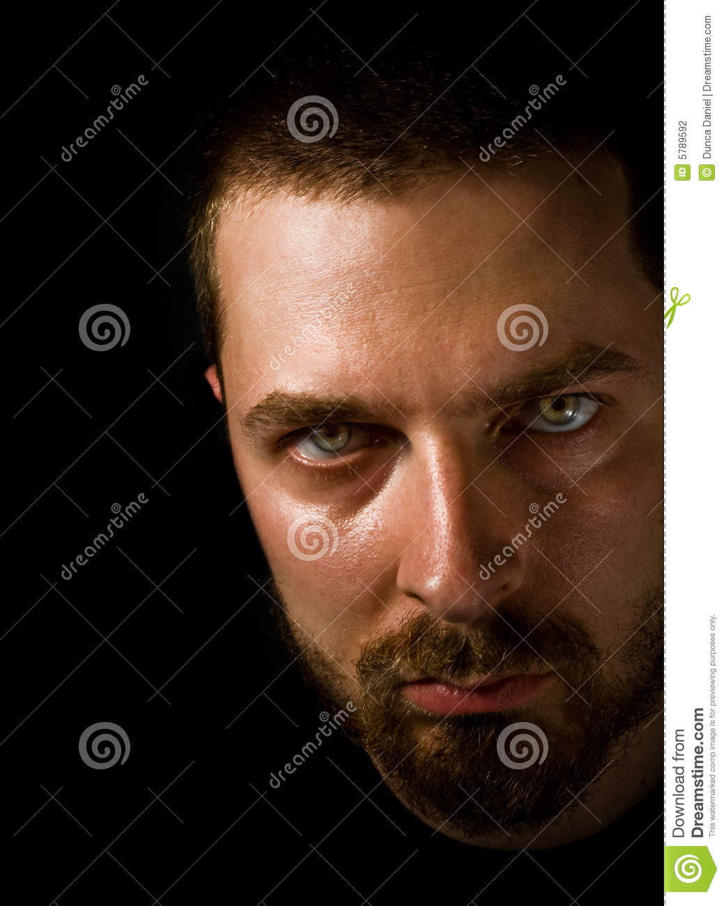 Man In The Dark With Evil Eyes Stock Photography Image