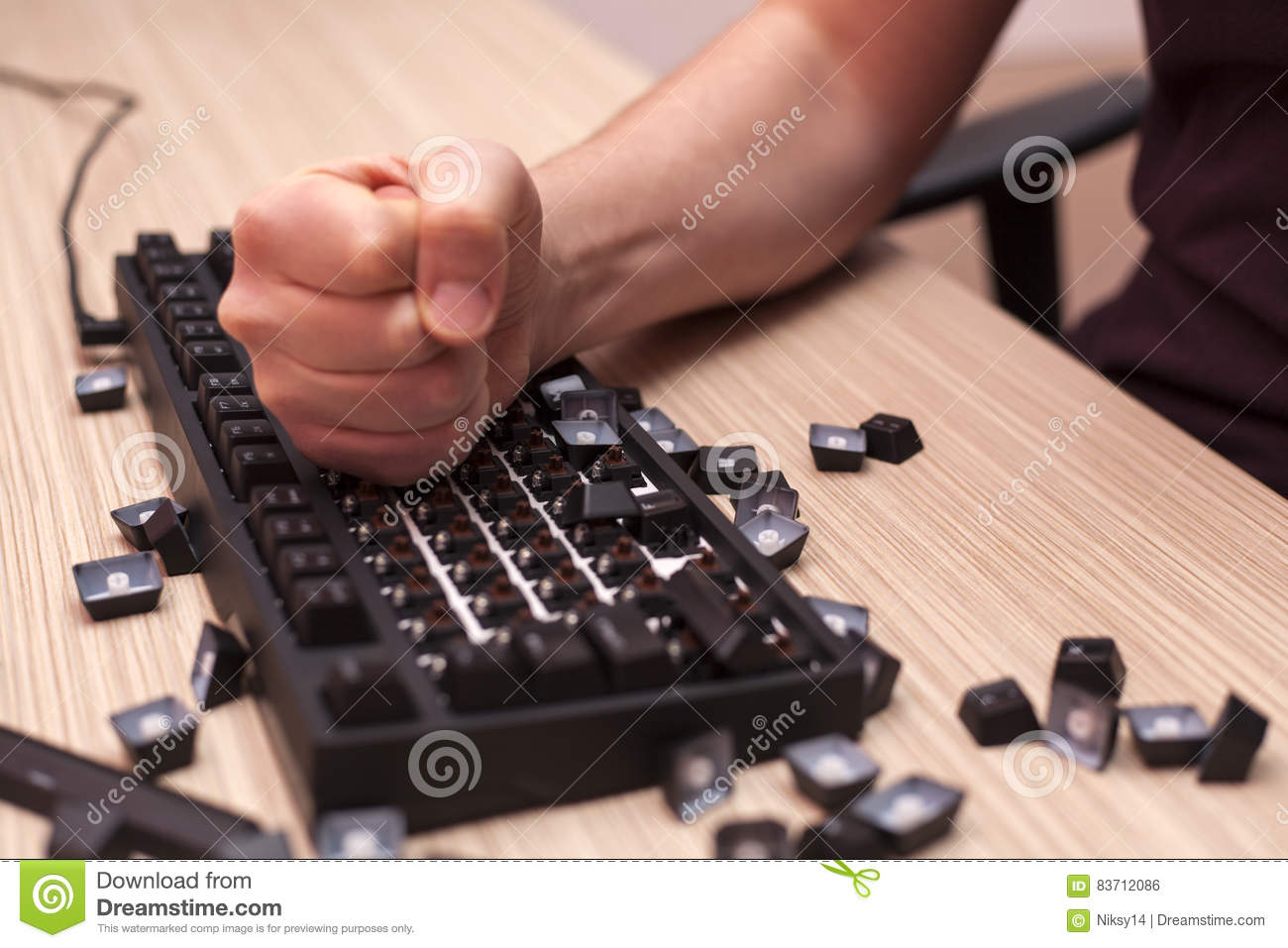 Man decisively destroys a mechanical computer keyboard in rage using one fist