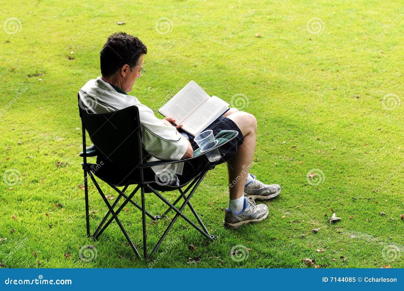 Man in deckchair reading