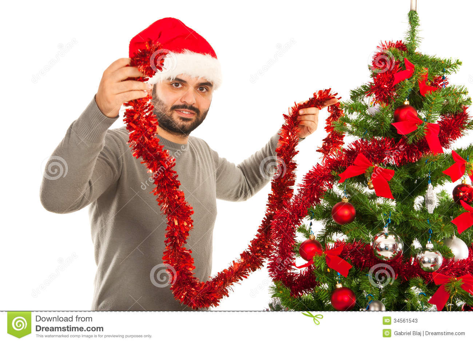 happy man decorate christmas tree royalty free stock photo - image