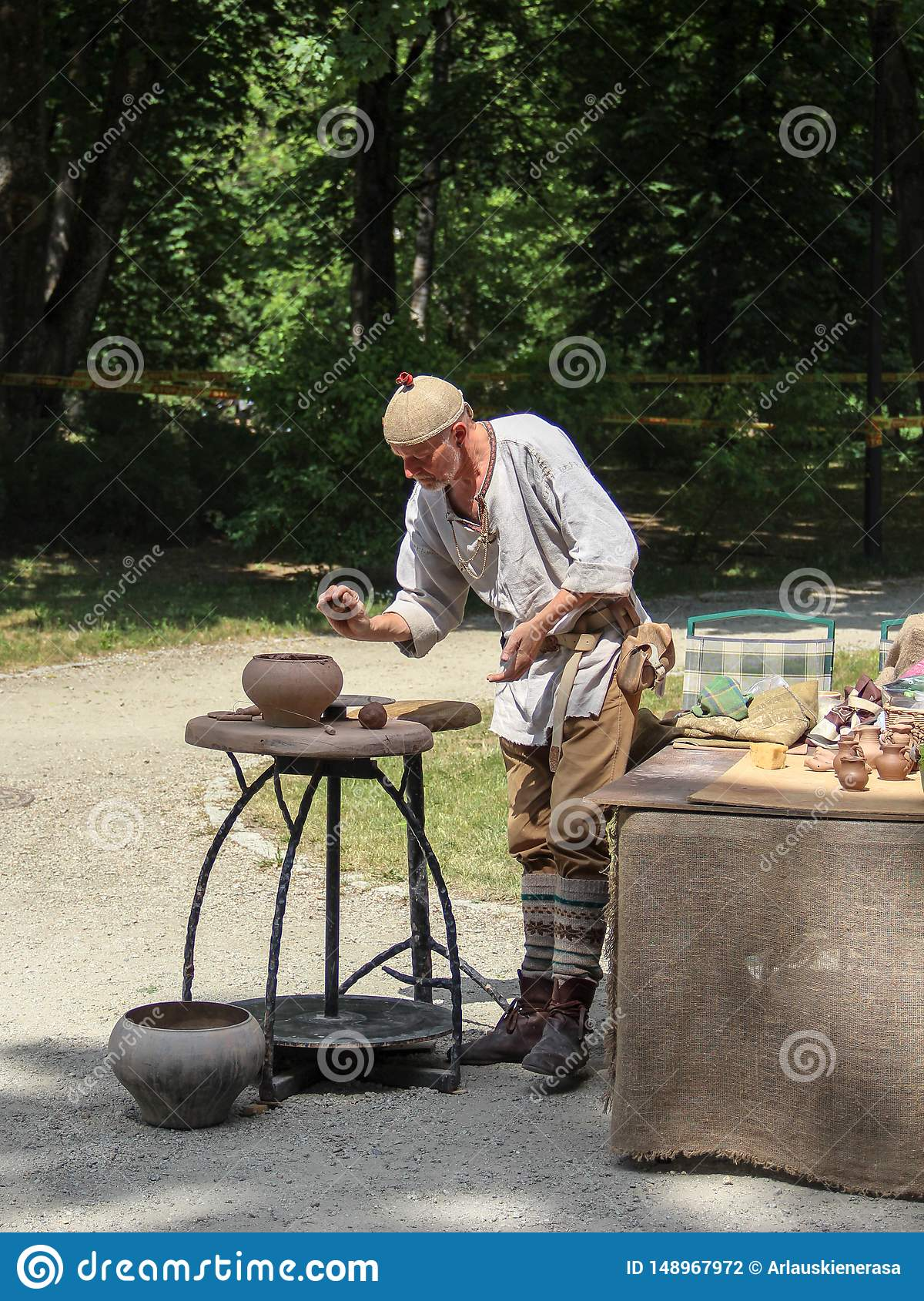A man demonstrating old potter crafts