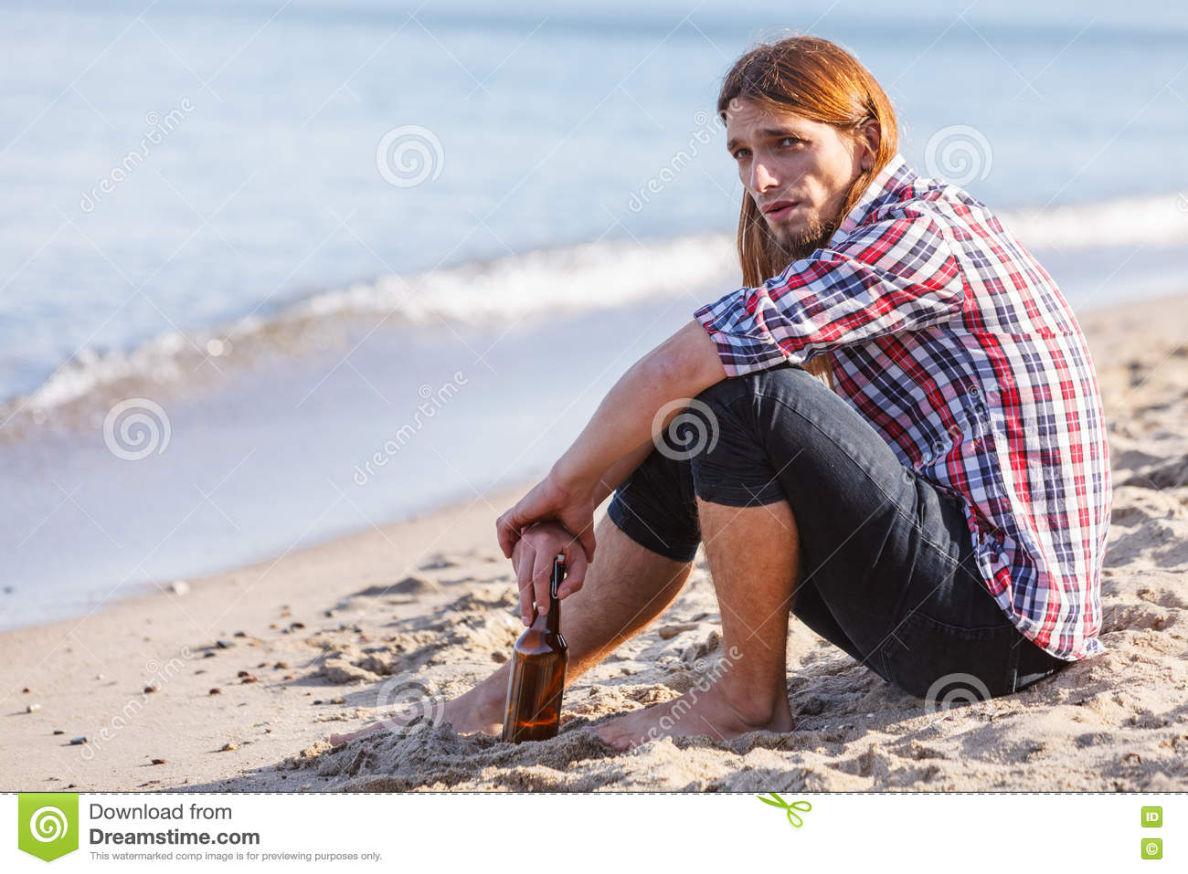 man-depressed-wine-bottle-sitting-beach-outdoor-people-abuse-alcoholism-problems-81123126.jpg