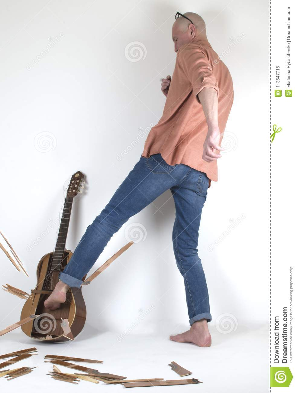 The Man In Despair Breaking Guitar By His Leg Stock Image