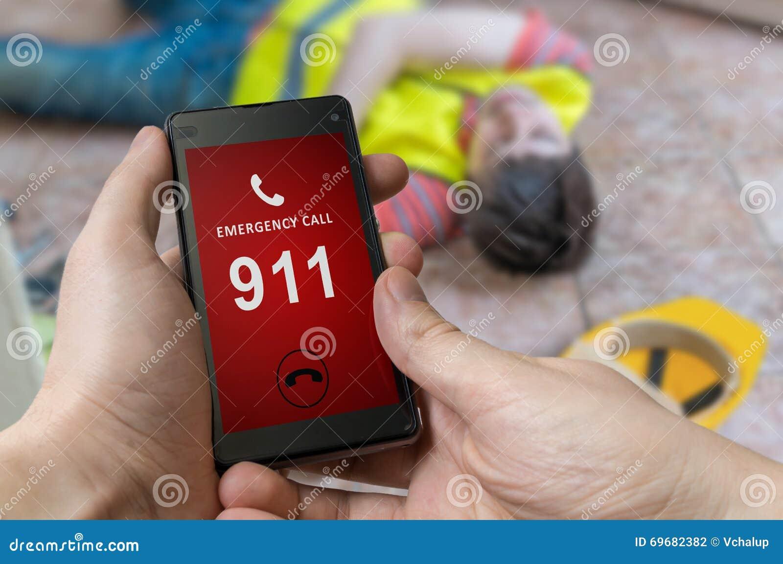 Man dialing emergency (911 number) on smartphone. Injured worker