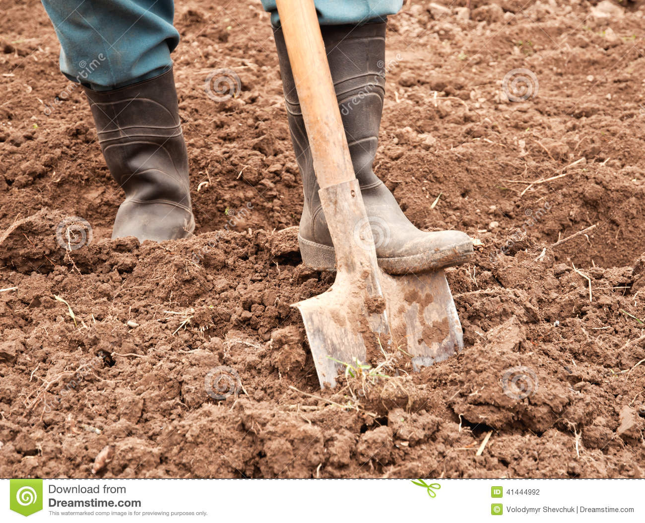 Man dig a shovel stock photo image 41444992 for Digging ground dream meaning