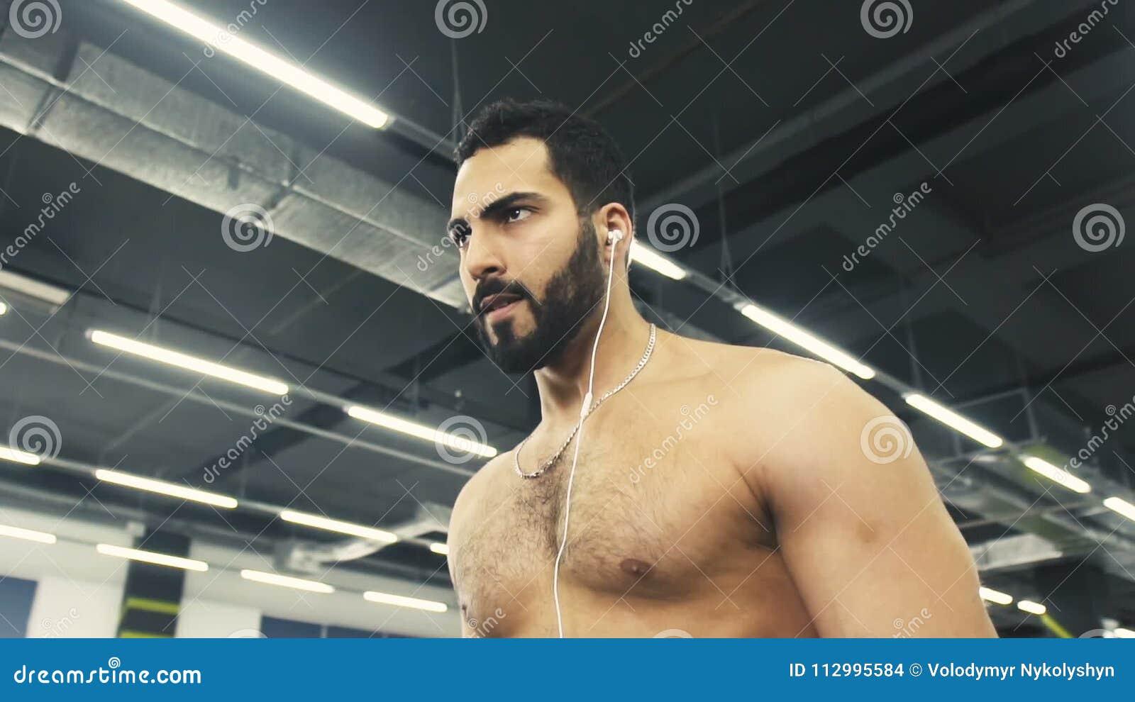 Man Does Biceps Workout