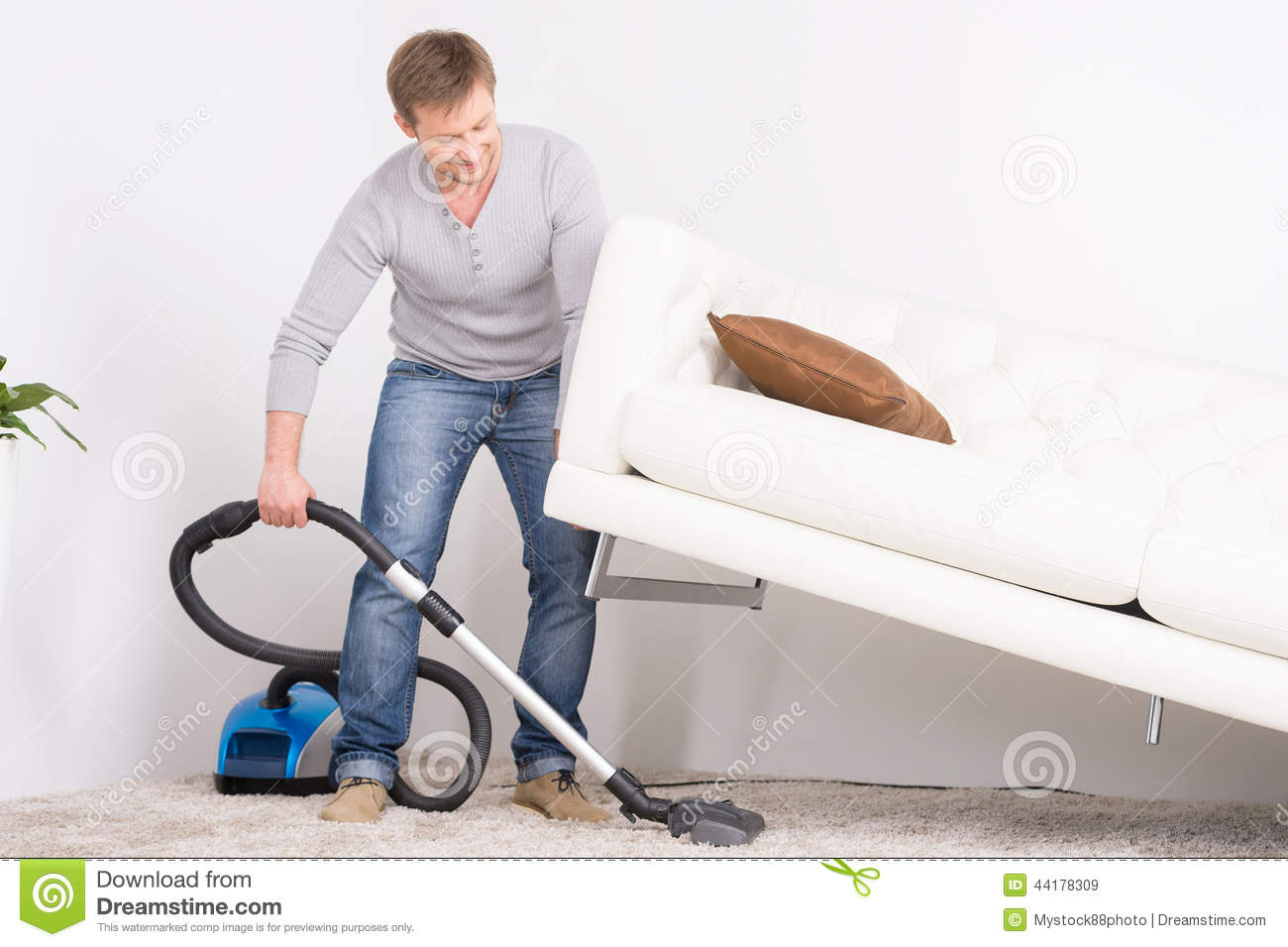 Man Does House Work With Vacuum Cleaner Stock Image Image Of Couch Inside 44178309