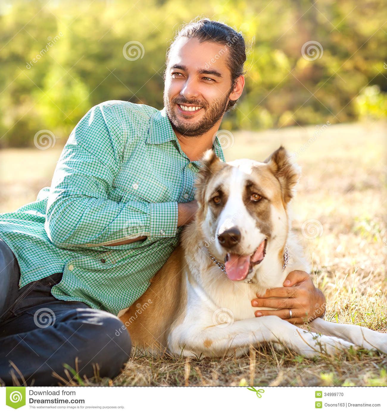 Man On Dog : Man and dog in park stock photo image of middle pedigree